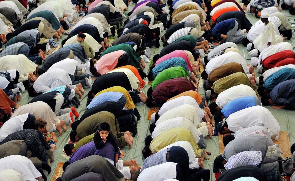 Men along with some children take part in Eid al-Fitr prayer service to celebrate the completion of Ramadan Monday morning, Jul 28, 2014, at the Muslim Community Center of the Capital District in Colonie, N.Y. (Paul Buckowski / Times Union)
