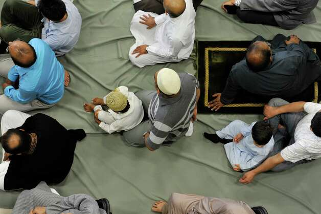 Men along with some children take part in Eid al-Fitr prayer service to celebrate the completion of Ramadan Monday morning, Jul 28, 2014, at the Muslim Community Center of the Capital District in Colonie, N.Y.  (Paul Buckowski / Times Union) Photo: Paul Buckowski / 00027904A