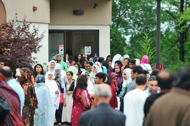 Women make their way outside following Eid al-Fitr prayer service to celebrate the completion of Ramadan Monday morning, Jul 28, 2014, at the Muslim Community Center of the Capital District in Colonie, N.Y.  (Paul Buckowski / Times Union) Photo: Paul Buckowski / 00027904A