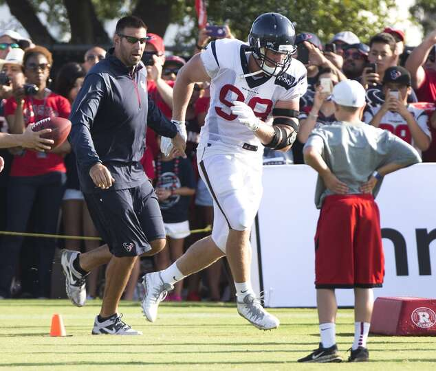 Day 3: July 28  Texans linebackers coach Mike Vrabel, left, works w