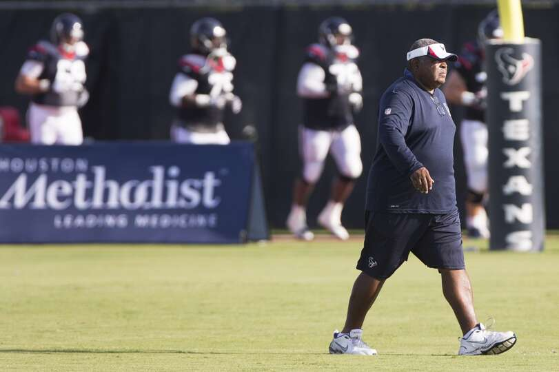 Day 3: July 28  Texans defensive coordinator Romeo Crennel walks ac