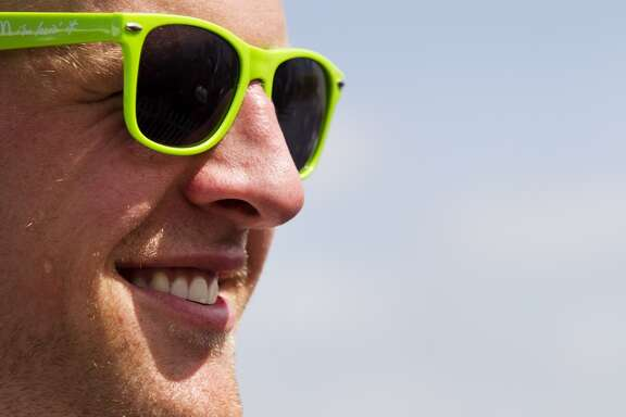 Day 3: July 28      Texans defensive end J.J. Watt wears a pair of green sunglasses at the end of practice as he goes to sign autographs.