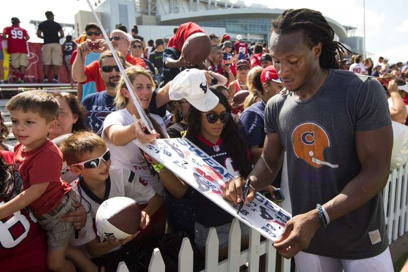 Day 3: July 28  Texans wide receiver DeAndre Hopkins, right, signs
