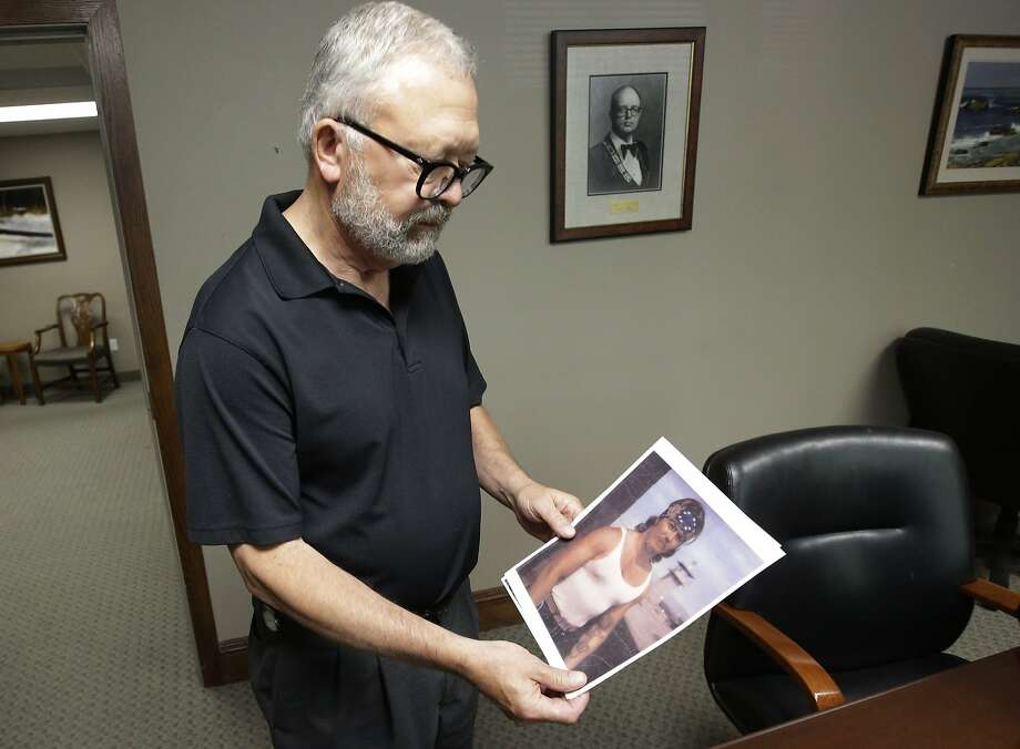 Attorney Jesse Trentadue holds a photograph of his brother Kenneth, who died in a holding cell in Oklahoma City several months after the 1995 bombing. Photo: Rick Bowmer, Associated Press