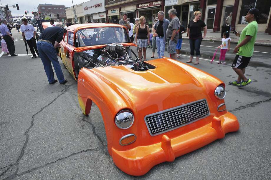 His ol' '55: Classic car buffs examine Don Lussier's 1955 Chevy drag racer with a detachable front end at the Pittsfield Ethnic Fair and Classic Car Show in Pittsfield, Mass. Photo: Gillian Jones, Associated Press
