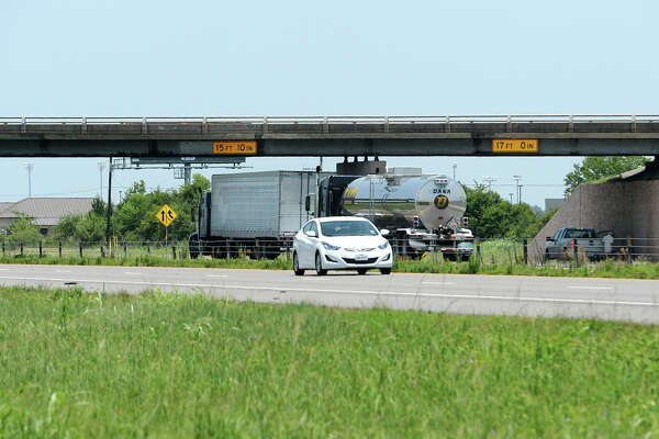 Cars pass under the Major Drive overpass on Interstate 10 on Monday afternoon. A plan to reverse the roadways' positions with an I-10 overpass over Major Drive is still several years away from realization. Photo taken Monday 7/28/14 Jake Daniels/@JakeD_in_SETX