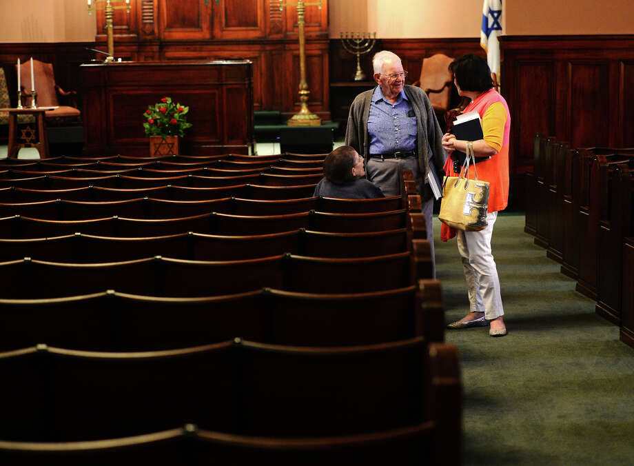 Linda and Herb Goldstein, left and center, talk with Mindy Eisen before Shabbat services Friday. Rabbi Joshua Taub led Friday night Shabbat services at Temple Emanuel, the area's only Jewish place of worship. The temple could be in danger of closing down sometime in the future due to sagging membership.  Photo taken Friday 7/25/14 Jake Daniels/@JakeD_in_SETX Photo: Jake Daniels / ©2014 The Beaumont Enterprise/Jake Daniels