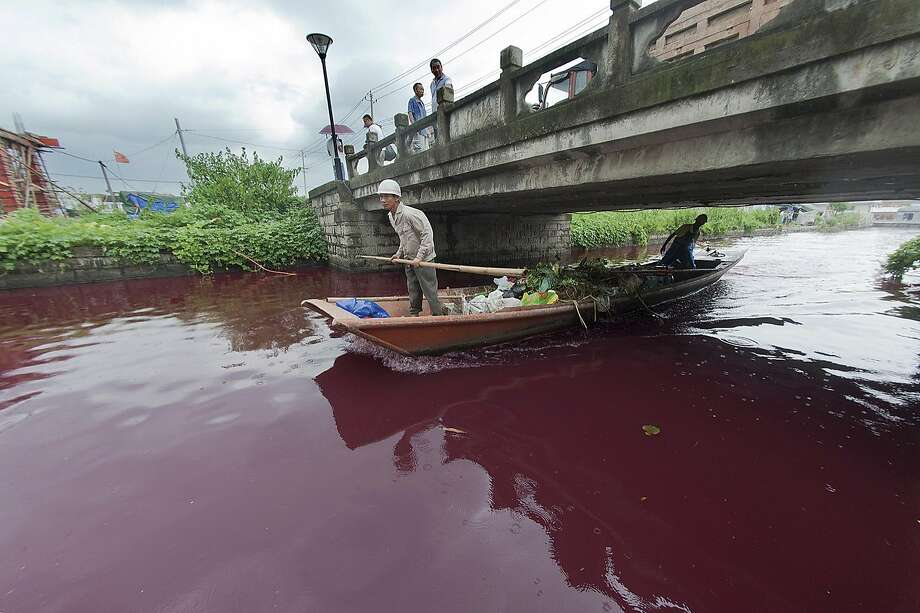 River of 'blood': A waterway turned a deep red overnight in Cangnan county, east China's Zhejiang 