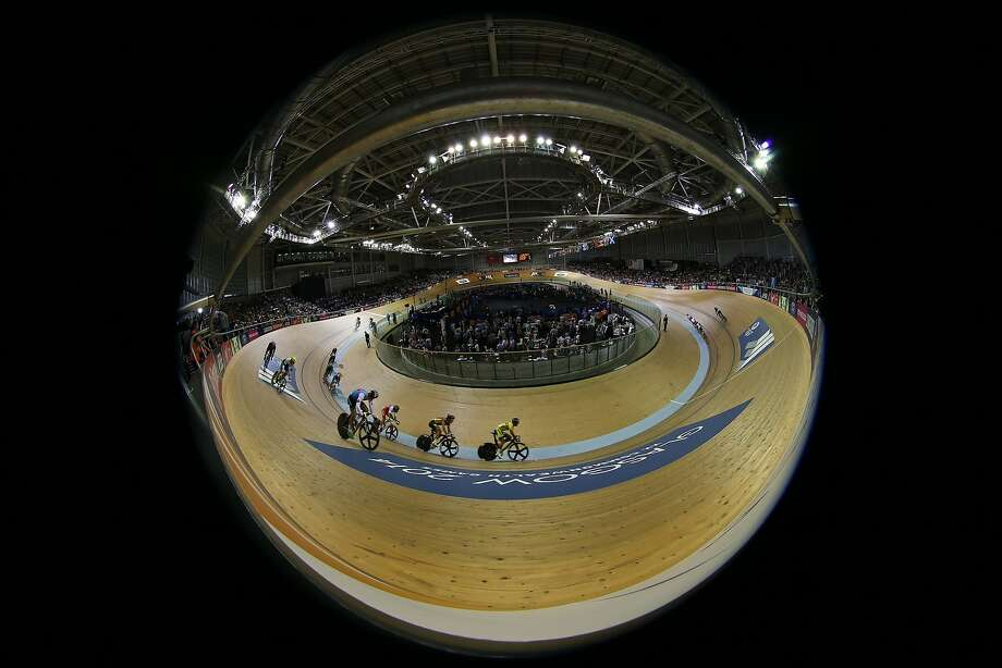 Velodrome snow globe: Cyclists compete in the men's 20k scratch race in this fish-eye 
