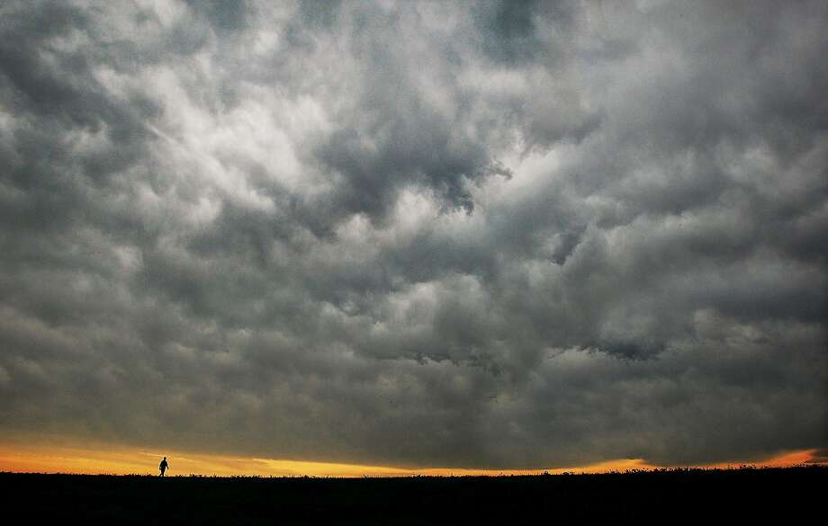Any minute now:Pretty sure it's going to rain in Alton, Ill. Photo: John Badman, Associated Press