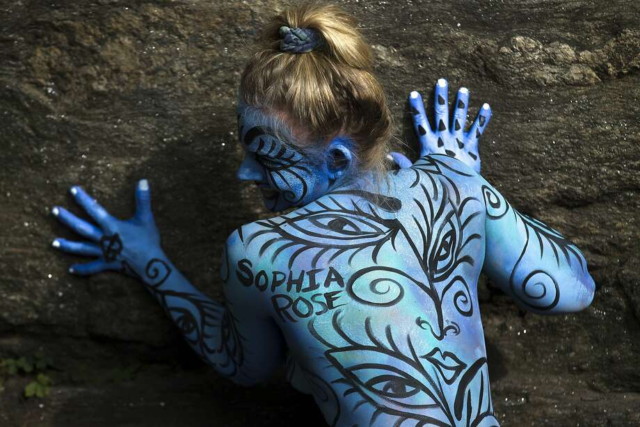 Her body is their canvas:Debbie McCabe poses after being painted during artist Andy Golub's inaugural Bodypainting Day at 