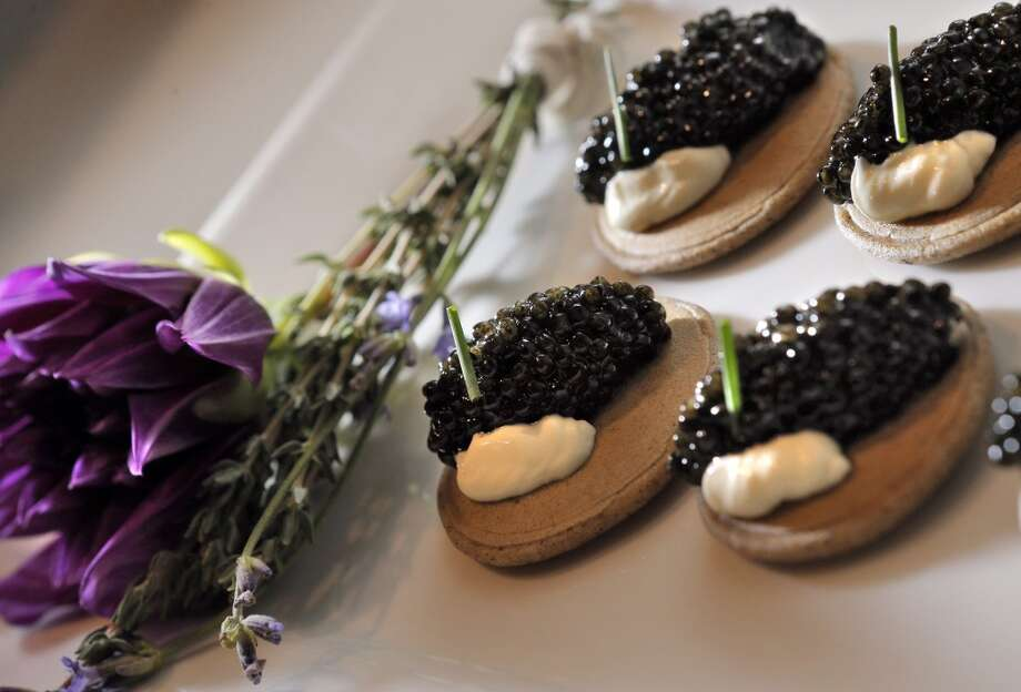 The Buckwheat blinis with Petrossian Royal Transmontanus Caviar and whipped Creme Fraiche appetizer served during the Top 100 Newcomers fundraising dinner for the San Francisco/Marin Food Bank at The Cavalier in San Francisco, Calif., on Sunday, July 27, 2014. The Chronicle helped organize the dinner as part of the Eat Drink SF festival. Photo: The Chronicle