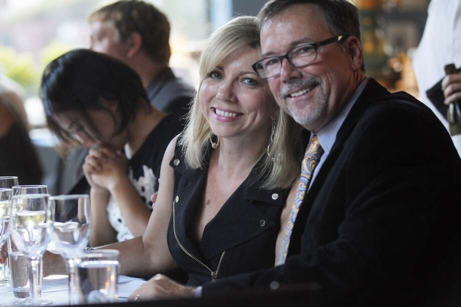 Scott and Kristin White of San Ramon, wait for the begininng courses to be served during the Top 100 Newcomers fundraising dinner for the San Francisco/Marin Food Bank at The Cavalier in San Francisco, Calif., on Sunday, July 27, 2014. The Chronicle helped organize the dinner as part of the Eat Drink SF festival. Photo: The Chronicle