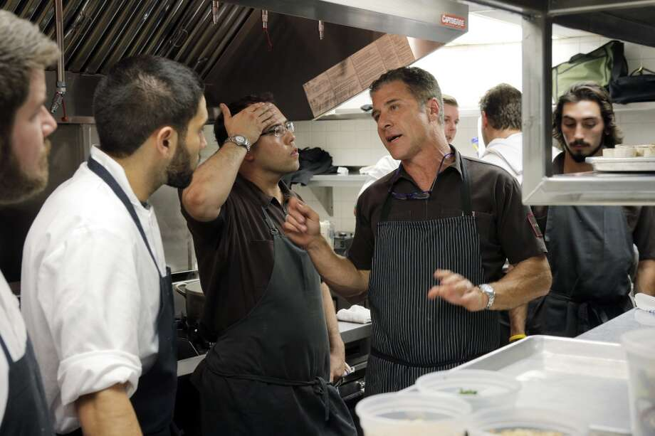 Chef Michael Chiarello goes over preparation of his dish in the kitchen during the Top 100 Newcomers fundraising dinner for the San Francisco/Marin Food Bank at The Cavalier in San Francisco, Calif., on Sunday, July 27, 2014. The Chronicle helped organize the dinner as part of the Eat Drink SF festival. Photo: The Chronicle