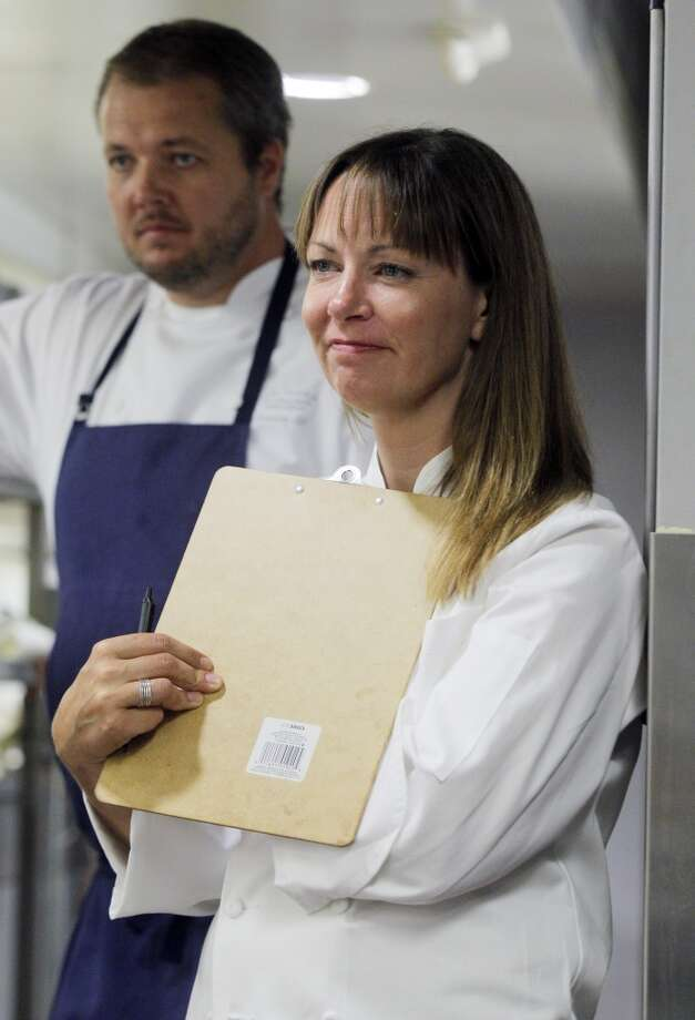 Chef Jennifer Puccio watches over the food prep in the kitchen during the Top 100 Newcomers fundraising dinner for the San Francisco/Marin Food Bank at The Cavalier in San Francisco, Calif., on Sunday, July 27, 2014. The Chronicle helped organize the dinner as part of the Eat Drink SF festival. Photo: Carlos Avila Gonzalez, The Chronicle