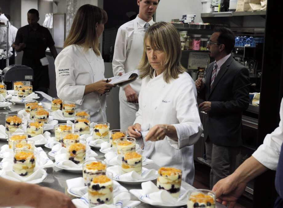 Pastry Chef Emily Luchetti makes sure everything is okay with dessert dishes during the Top 100 Newcomers fundraising dinner for the San Francisco/Marin Food Bank at The Cavalier in San Francisco, Calif., on Sunday, July 27, 2014. The Chronicle helped organize the dinner as part of the Eat Drink SF festival. Photo: Carlos Avila Gonzalez, The Chronicle