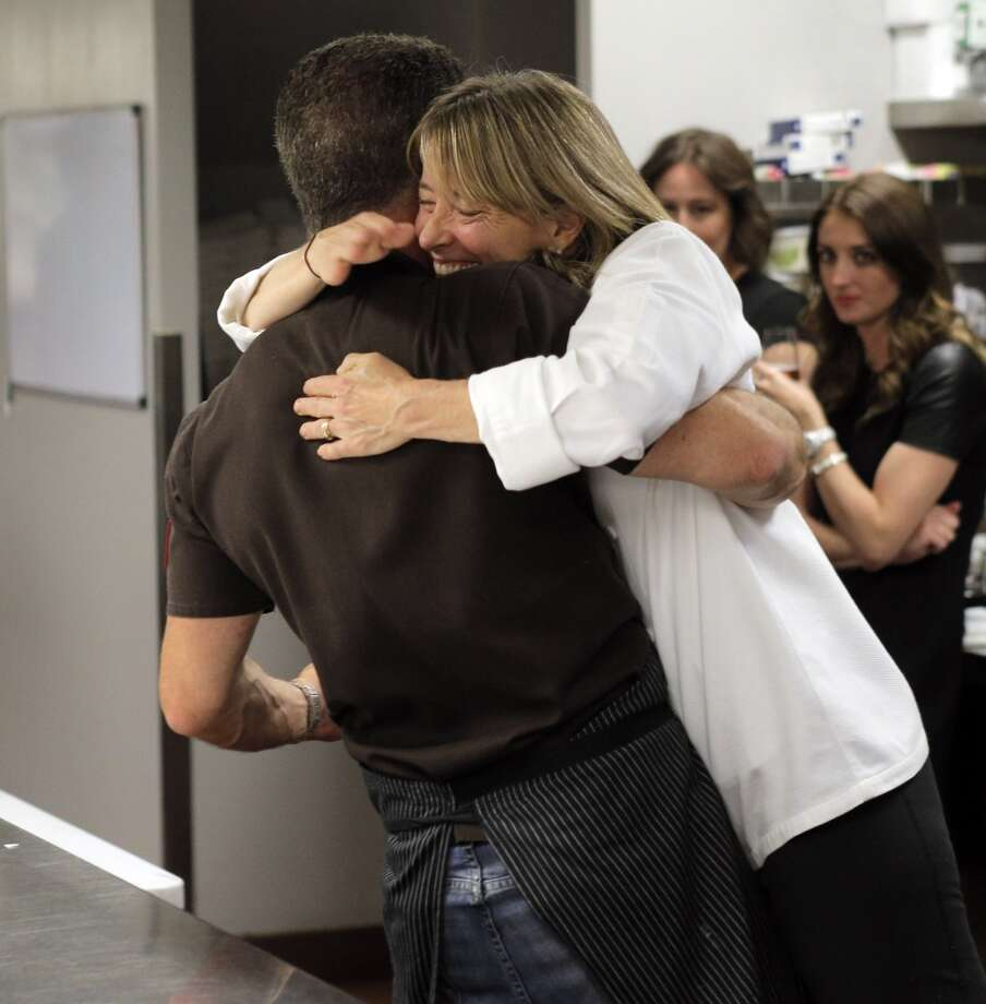 Chef Michael Chiarello, left, lifts up Pastry Chef Emily Luchetti as he hugs her in the kitchen during the Top 100 Newcomers fundraising dinner for the San Francisco/Marin Food Bank at The Cavalier in San Francisco, Calif., on Sunday, July 27, 2014. The Chronicle helped organize the dinner as part of the Eat Drink SF festival. Photo: Carlos Avila Gonzalez, The Chronicle