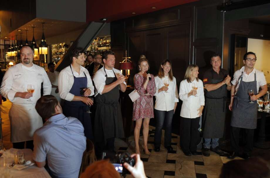 Anna Weinberg, center, introduces the chefs who put together the Top 100 Newcomers fundraising dinner for the San Francisco/Marin Food Bank at The Cavalier in San Francisco, Calif., on Sunday, July 27, 2014. From left to right are Andrew Cain of Sante, Nico Delaroque of Nico, Tyler Florence of Wayfare Tavern, Jennifer Puccio and Emily Luchetti of The Cavalier, Michael Chiarello of Coqueta, and Shotaro Kamio of Iyasare. The Chronicle helped organize the dinner as part of the Eat Drink SF festival. Photo: Carlos Avila Gonzalez, The Chronicle