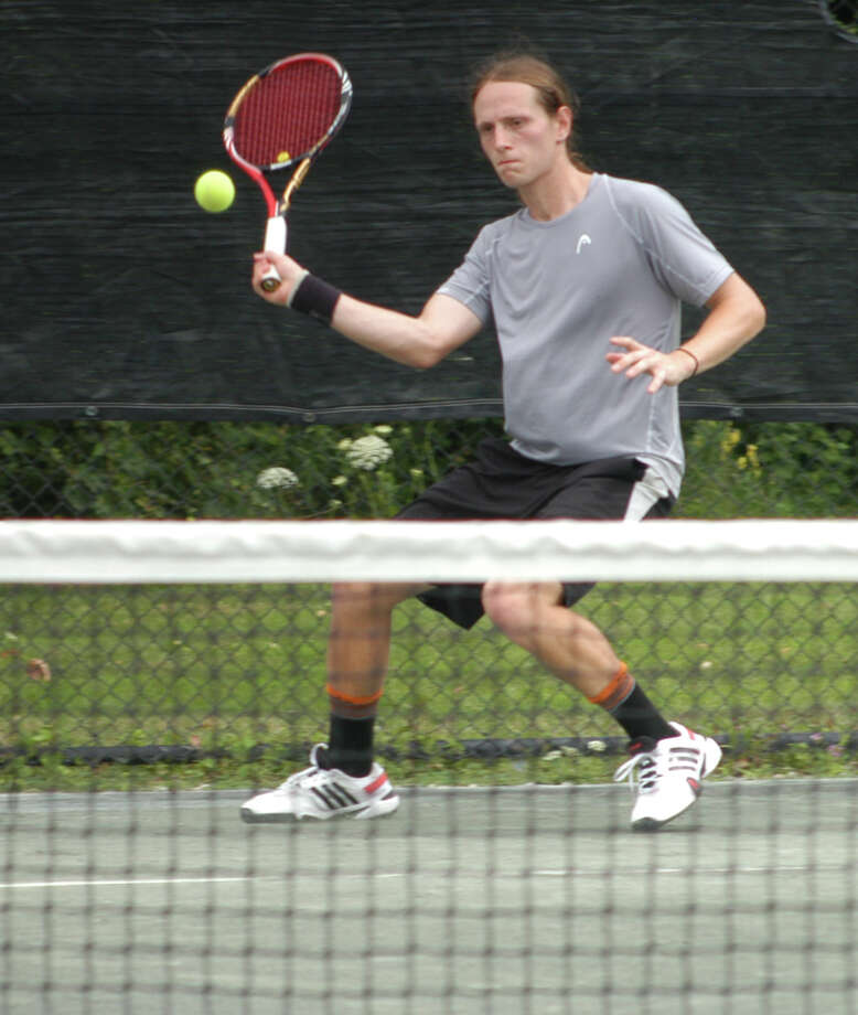 Joshua Heilweil, returning a shot to Nic Visinski, won the men's open title on Sunday, July 27 for the 75th annual Fairfield Town Tennis Tournament at the Fairfield Tennis Center on Old Dam Road. Heilweil won 4-6, 6-1, 6-1 over his former Mustangs' teammate. Photo: Andy Hutchison / Fairfield Citizen