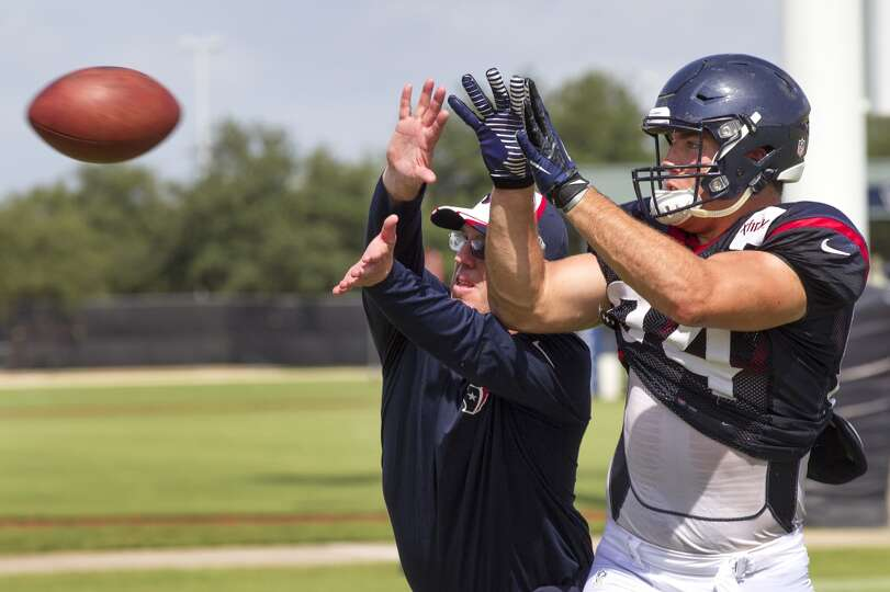 Day 3: July 28   Texans tight ends coach John Perry, left, works wi