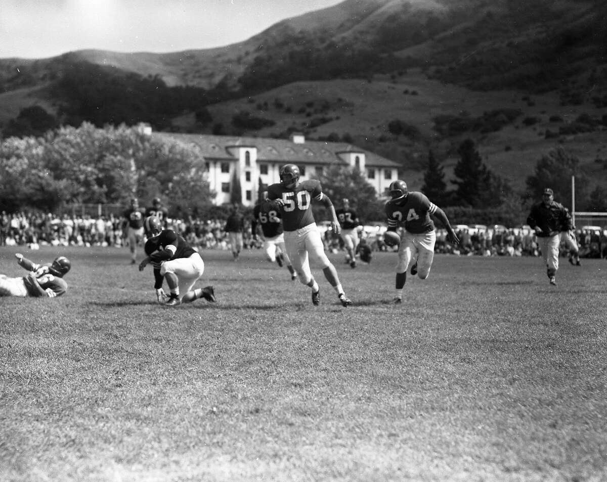 The 49ers practice at St. Mary's College in Moraga on Aug. 11, 1956. The 49ers practiced at St. Mary's into the 1960s.