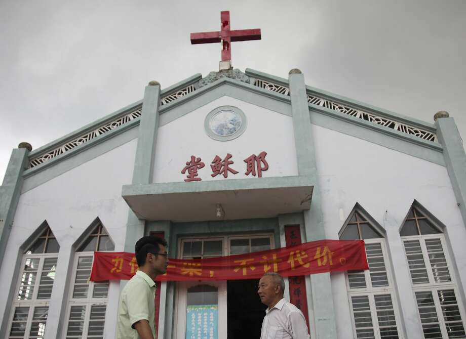 "A banner at a Christian church in Wenzhou this month reads ""Protect the cross, at all costs."" Photo: Didi Tang, Associated Press"