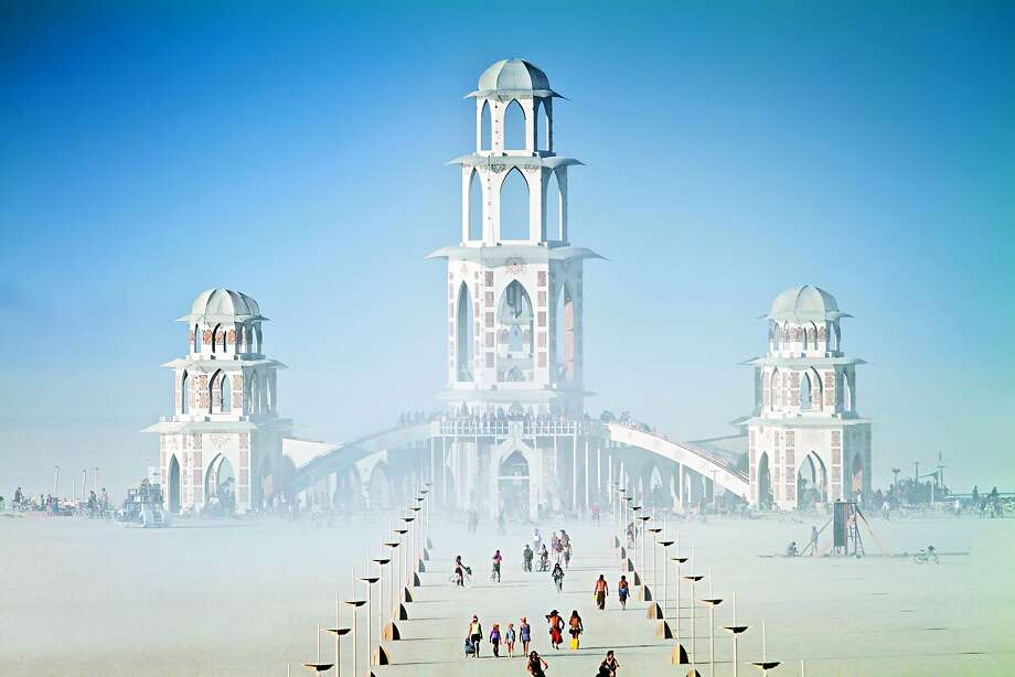 "Burning Man's most sacred space is the Temple, the festival's annual homage to the spiritual, which goes up in flames. The ""Temple of Transition"" (2011), constructed by International Arts Megacrew, was one such structure. Photo: Scott London, Race Point Publishing"