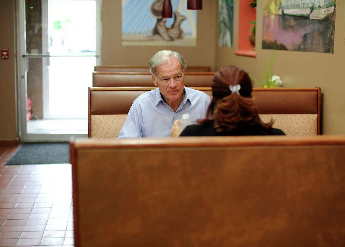 Tom Foley, the endorsed Republican candidate for Connecticut governor, left, eats lunch with New Britain Mayor Erin Stewart during a campaign stop in New Britain, Conn, Monday, July 28, 2014. A new online poll conducted by the nonpartisan research firm YouGov in partnership with the New York Times and CBS News shows Foley leading Democratic incumbent Dannel P. Malloy 42 percent to 33 percent.