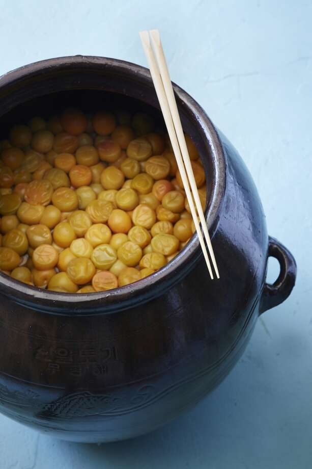 Umeboshi, Japanese pickled plums, in a crock in Sylvan Brackett's backyard culinary lab. Photo: Aya Brackett, Special To The Chronicle