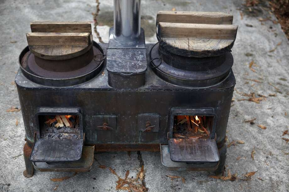 "An old kamado, or wood-fired stove from Japan.rackett, rests in the backyard. Brackett uses it for cooking rice over a live fire for parties. ""It's quite a functional little thing,"" he says. The metal pots that sit over the kindling get extremely hot and can be used for frying tempura or simmering soup, says the chef. Photo: Aya Brackett, Special To The Chronicle"