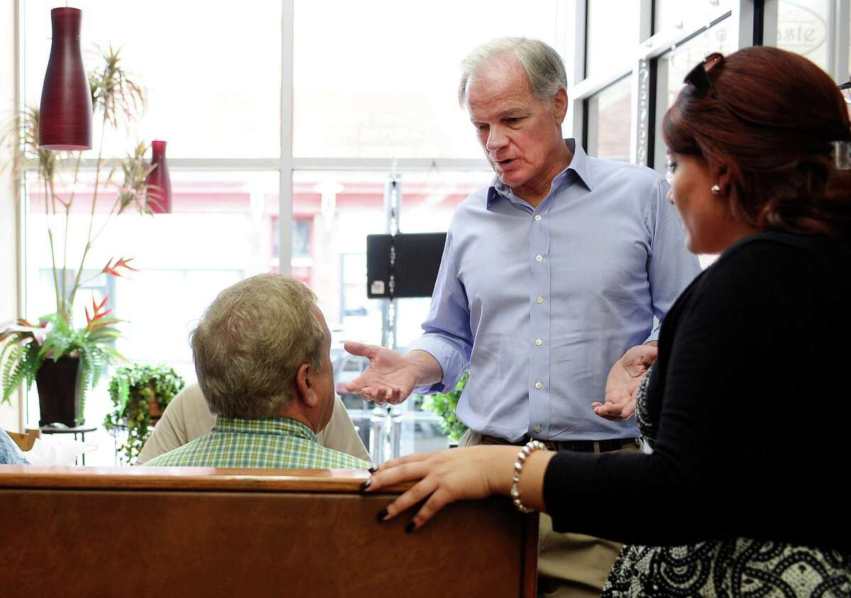 Tom Foley, the endorsed Republican candidate for Connecticut governor, center, speaks with Andrew Kowalski, left, as New Britain Mayor Erin Steward, right, looks on, as Foley greets diners in New Britain, Conn, Monday, July 28, 2014. A new online poll conducted by the nonpartisan research firm YouGov in partnership with the New York Times and CBS News shows Foley leading Democratic incumbent Dannel P. Malloy 42 percent to 33 percent.