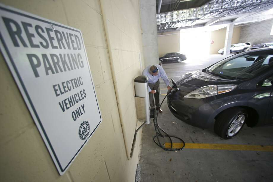 An alliance of automakers and utilities plans to develop a communications platform that allows utilities and electric cars to exchange information. Photo: John Raoux, Associated Press