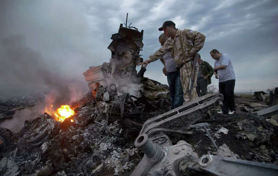 When inspectors arrived at the crash site of Malaysia Airlines Flight 17, they found the cabin had been chainsawed into pieces. Photo: Dmitry Lovetsky / Associated Press / AP