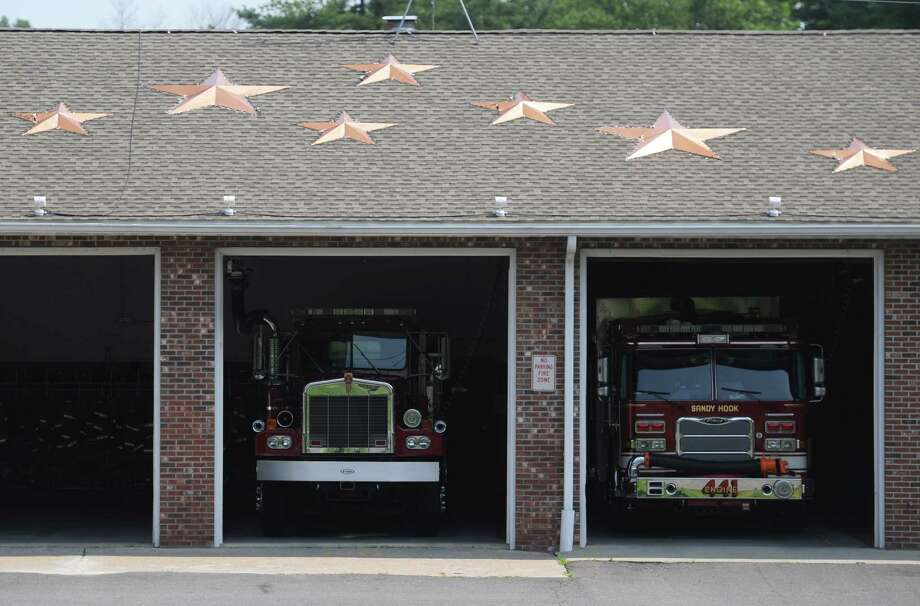 Stars on the roof of the Sandy Hook Volunteer Fire & Rescue Company building, pictured here on Friday, July 25, 2014, serve as a private memorial for the victims of the Sandy Hook Elementary School shooting on Dec. 14, 2012. The Newtown Permanent Memorial Commission is considering a public memorial that would reflect the wishes of the families and those closest to the tragedy as well as the general community. Photo: Tyler Sizemore / The News-Times