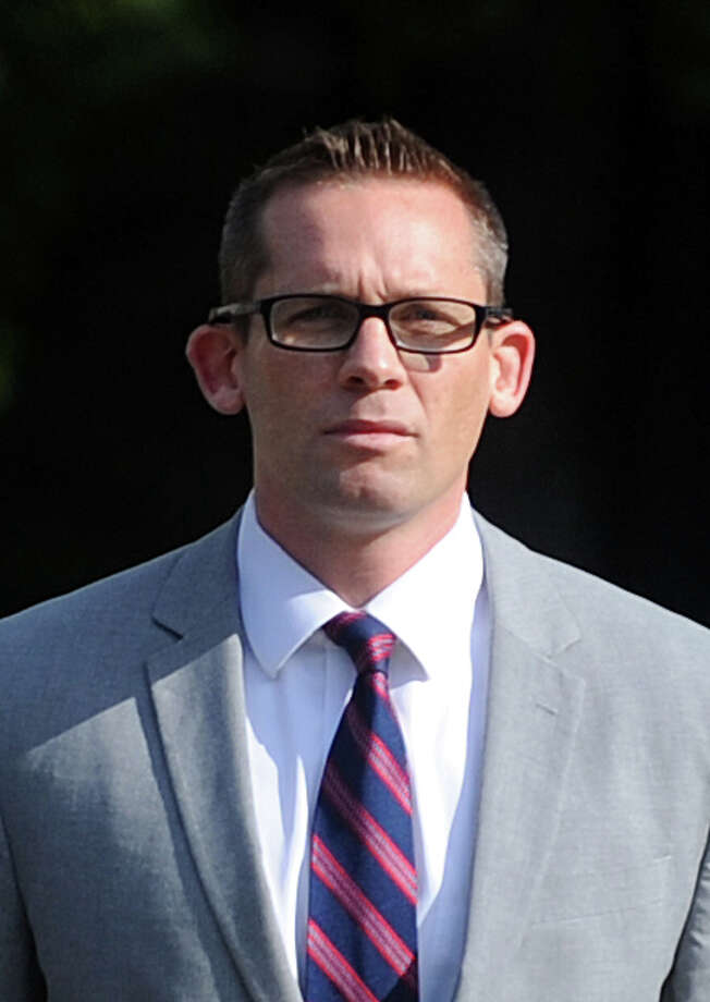 Johnathan Nathans, former catcher for the Bridgeport Bluefish, arrives at the federal courthouse in Bridgeport, Conn. on Thursday, July 17, 2014. The jury in the case of  Nathans vs. Offerman will begin deliberations Tuesday, July 29th to decide if Nathans should be awarded $4.7 million for injuries received an on-field bat attack that occurred on August 14, 2007. Photo: Autumn Driscoll / Connecticut Post