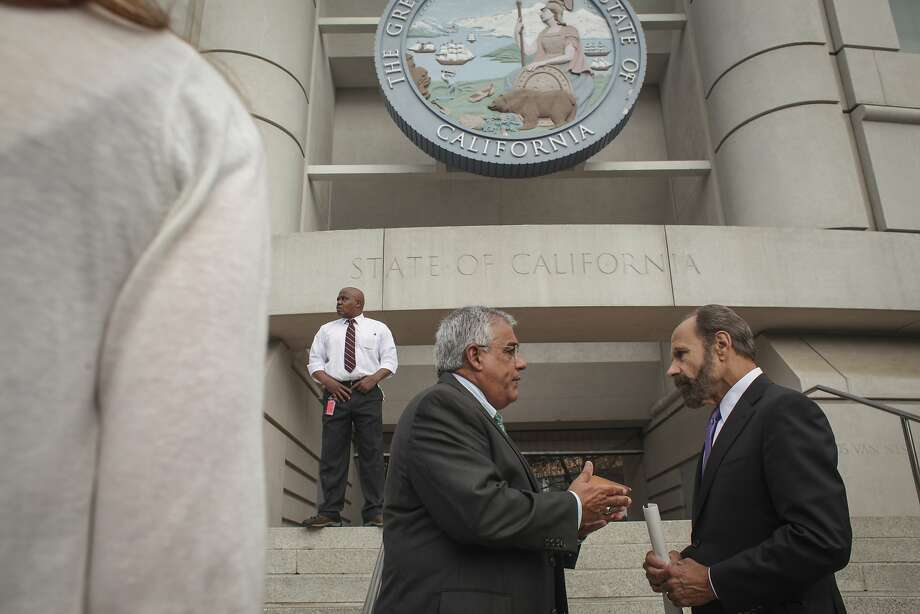 California State Senator Jerry Hill (left) mingles after a press event, held on the steps of the California Public Utilities Commission in San Francisco, announcing that the city of San Bruno will take action against the CPUC president Michael Peevey his senior staff and senior Pacific Gas & Electric Co. officials, on July 28th 2014. The City of San Bruno obtained email correspondences claiming to illustrate an inappropriate relationship between the Senior staff of the CPUC and PG&E. Photo: Sam Wolson, Special To The Chronicle