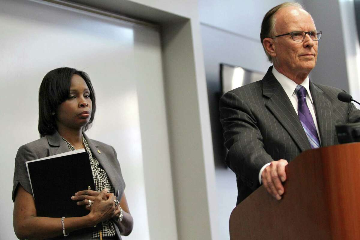 Mayor Ivy Taylor listens as Bexar County Judge Nelson Wolff speaks during a news conference on Monday, July 28, 2014, at the Municipal Plaza Building in San Antonio. Taylor called for $32 million the city had pledged to the VIA streetcar plan to be redirected to other city projects.