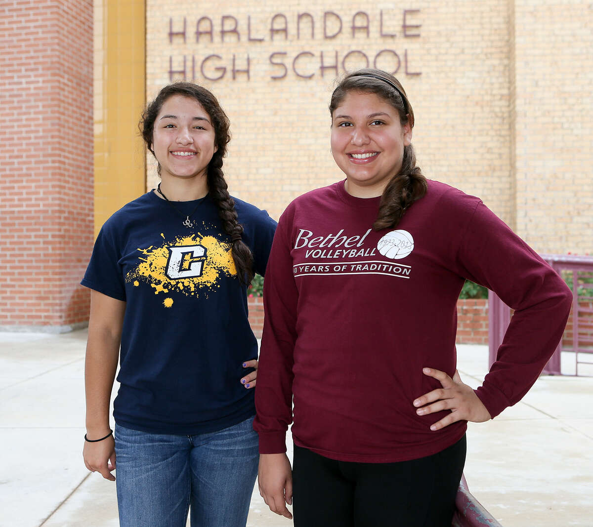 Harlandale graduates Katie Neira (right) and Sierrra Sandoval in front of the school on Friday, July 18, 2014. Neira and Sandoval are headed to Kansas this fall to play volleyball; Neira at Bethel College and Sandoval at Central Christian College. Photo by Marvin Pfeiffer / EN Communities