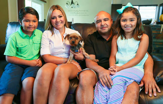 Aidan Delgado (from left), 7, Yvette Castillo, Juan Delgado and Leila Delgado, 7, with Brody, their six-year-old Yorkshire Terrier Brody was picked up by Animal Care Services on July 16 after being missing for sixteen months.  ACS identified Brody from his microchip and notified the family.  Photo by Marvin Pfeiffer / EN Communities Photo: MARVIN PFEIFFER, Marvin Pfeiffer / EN Communities / EN Communities 2014