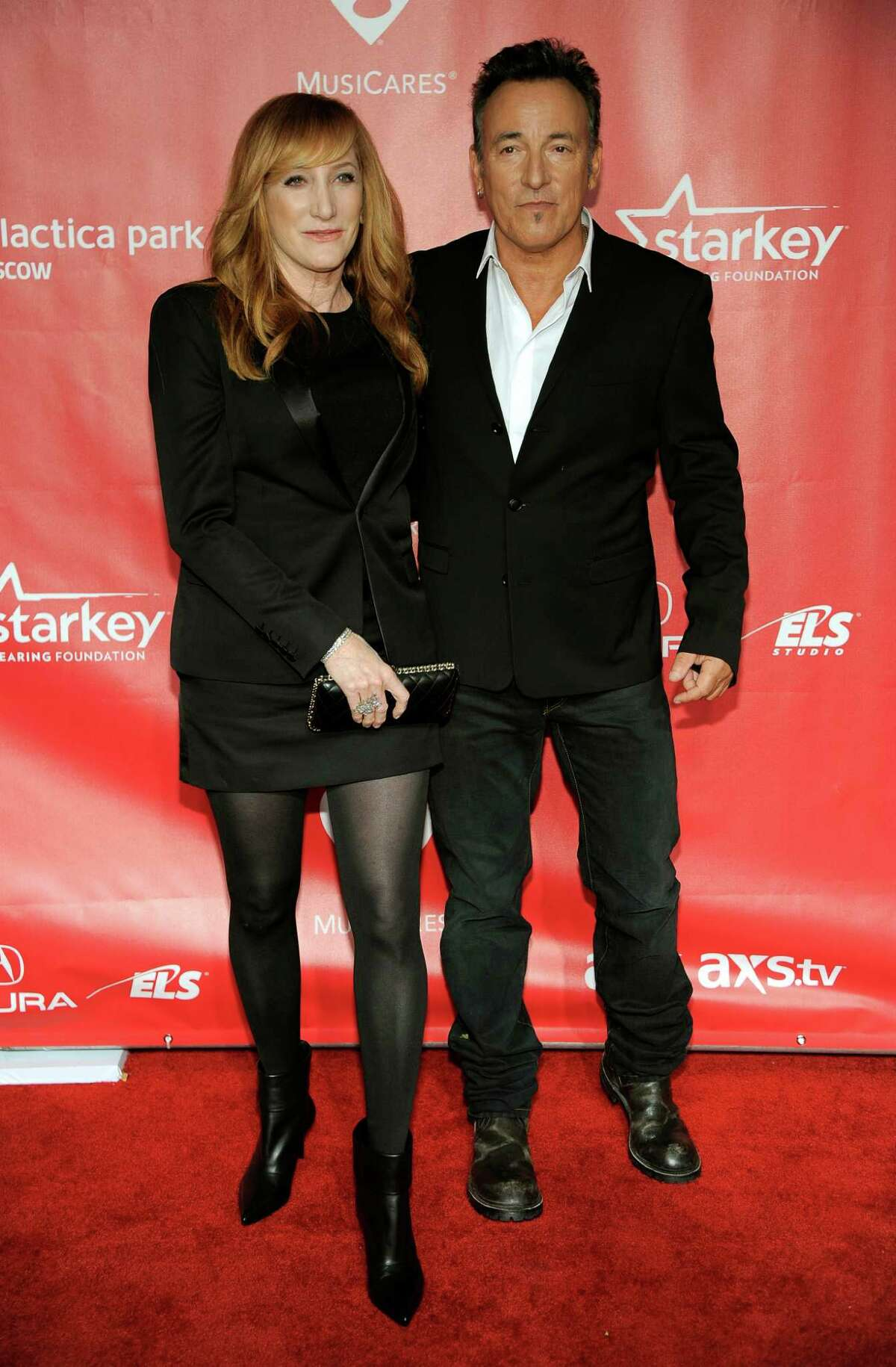 Honoree Bruce Springsteen, right, and Patti Scialfa arrive at Springsteen's MusiCares Person of the Year tribute at the Los Angeles Convention Center on Friday Feb. 8, 2013, in Los Angeles. (Photo by Chris Pizzello/Invision/AP)