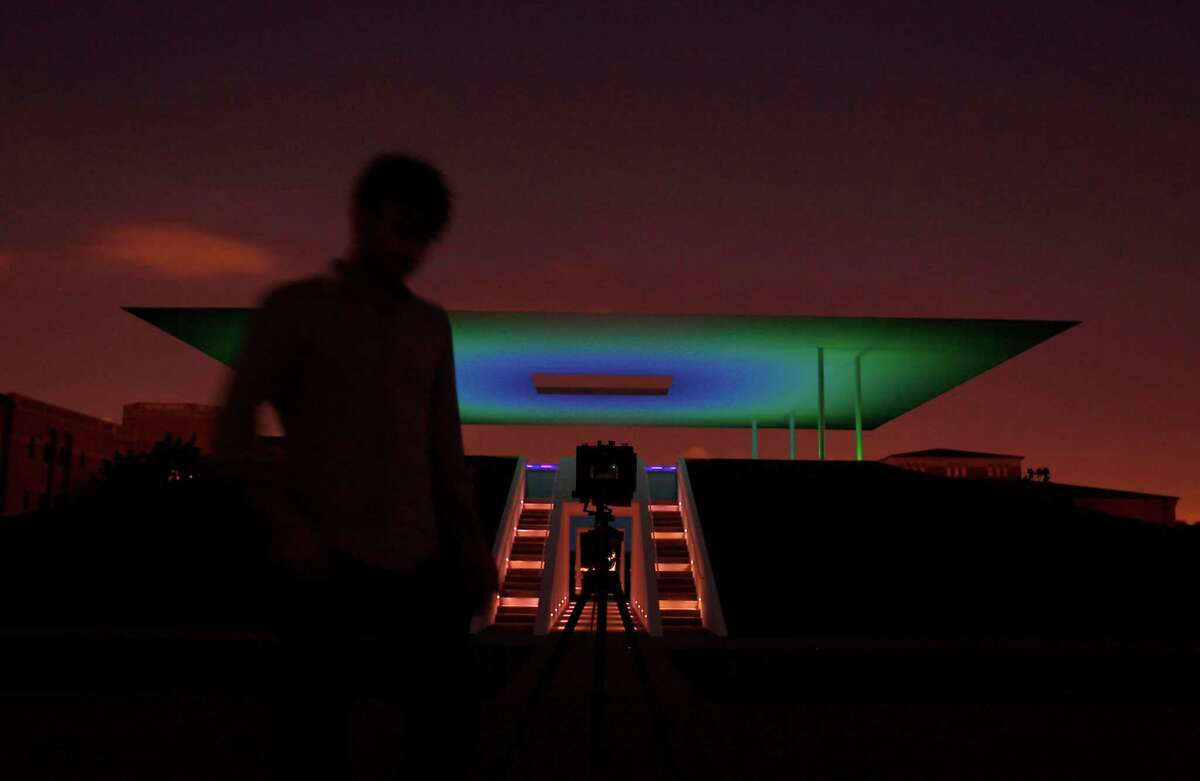 Photographer Casey Dunn takes photos of the new Skyspace by James Turrell at Rice University.