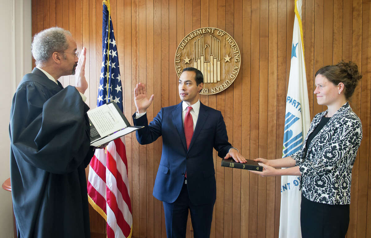 Julián Castro, center, is sworn in July 28, 2014 as the 16th Secretary for the U.S. Department of Housing and Urban Development.