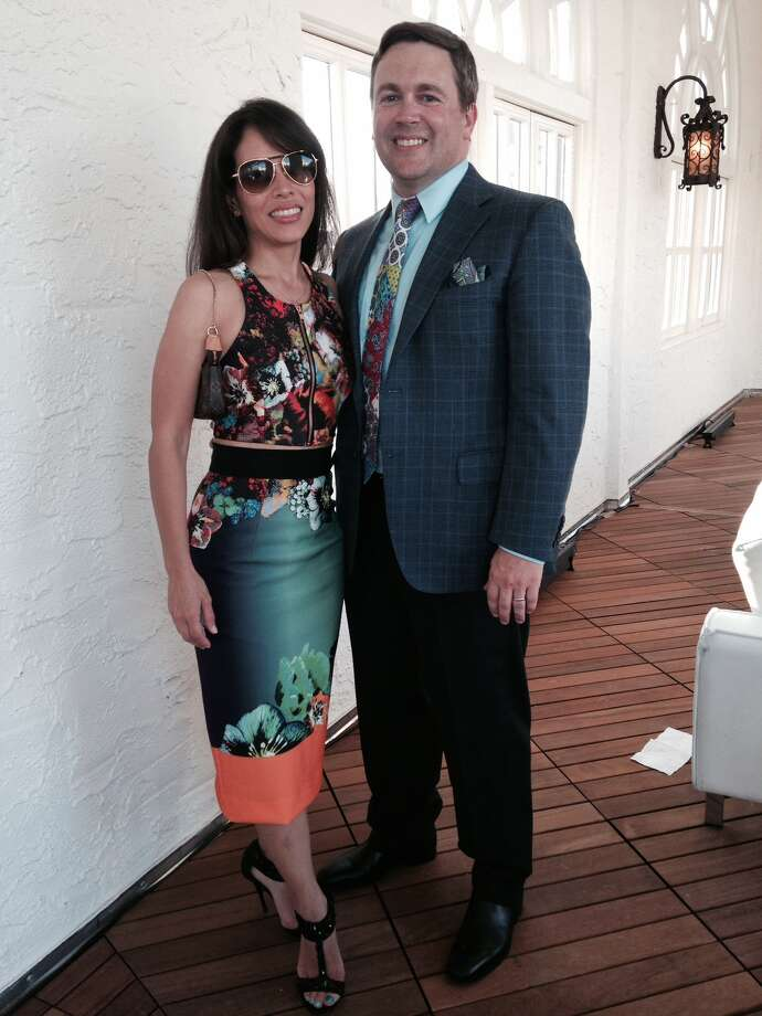 "Husband and wife Tim and Vanessa Bessler prove that they are fearless fashionistas in their mixed-print ensembles. Vanessa wears a crop top with a coordinating pencil skirt in a digital print design by Milly. She anchors her look with black-jeweled sandals by Elizabeth and James. Tim gets in on the print craze with his colorful Etro tie and pocket square that team well with his  muted plaid jacket by Canali.  ""We're contemporary chic,"" Vanessa said. Added Tim: ""What she said. I take lots of advice from her."" - Michael Quintanilla Photo: Photo By Michael Quintanilla / San Antonio Express-News"