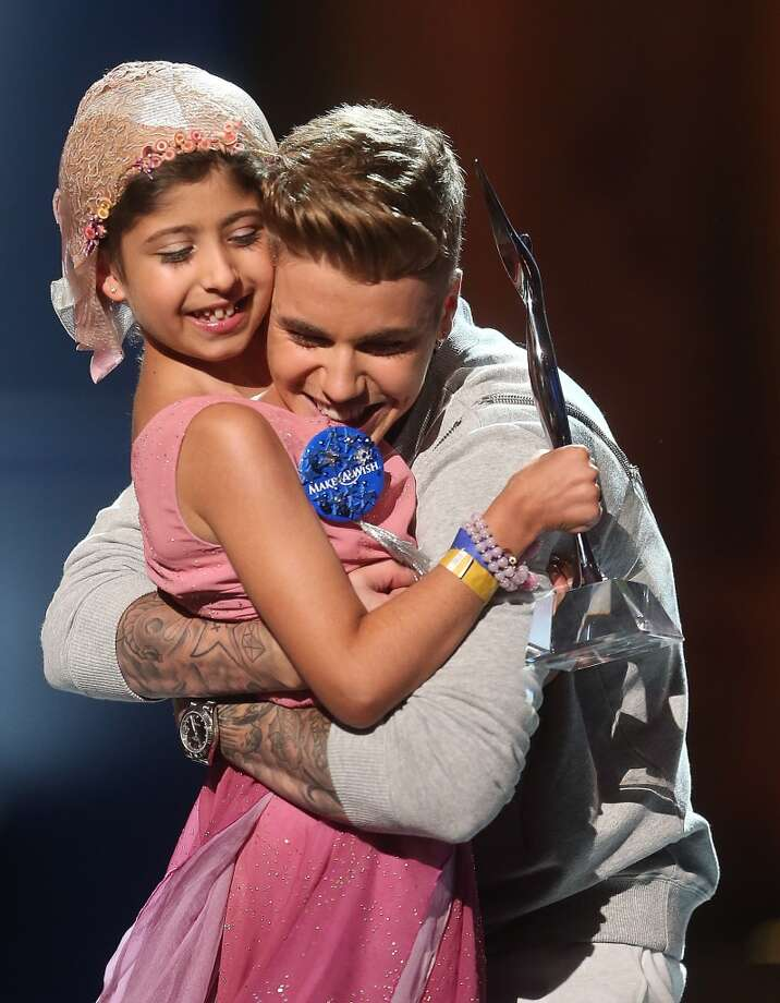 Make a Wish recipient Grace Kesablak and singer Justin Bieber (R) onstage at the 2014 Young Hollywood Awards brought to you by Samsung Galaxy at The Wiltern on July 27, 2014 in Los Angeles, California. Photo: Frederick M. Brown, Getty Images For Variety