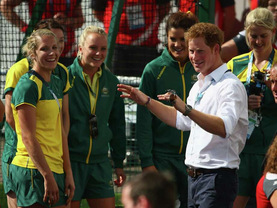 Prince Harry greets members of the Australian and the England women's hockey teams at Glasgow National Hockey Centre during day five of the Glasgow 2014 Commonwealth Games on July 28, 2014 in Glasgow, United Kingdom. Photo: Robert Cianflone, Getty Images / 2014 Getty Images