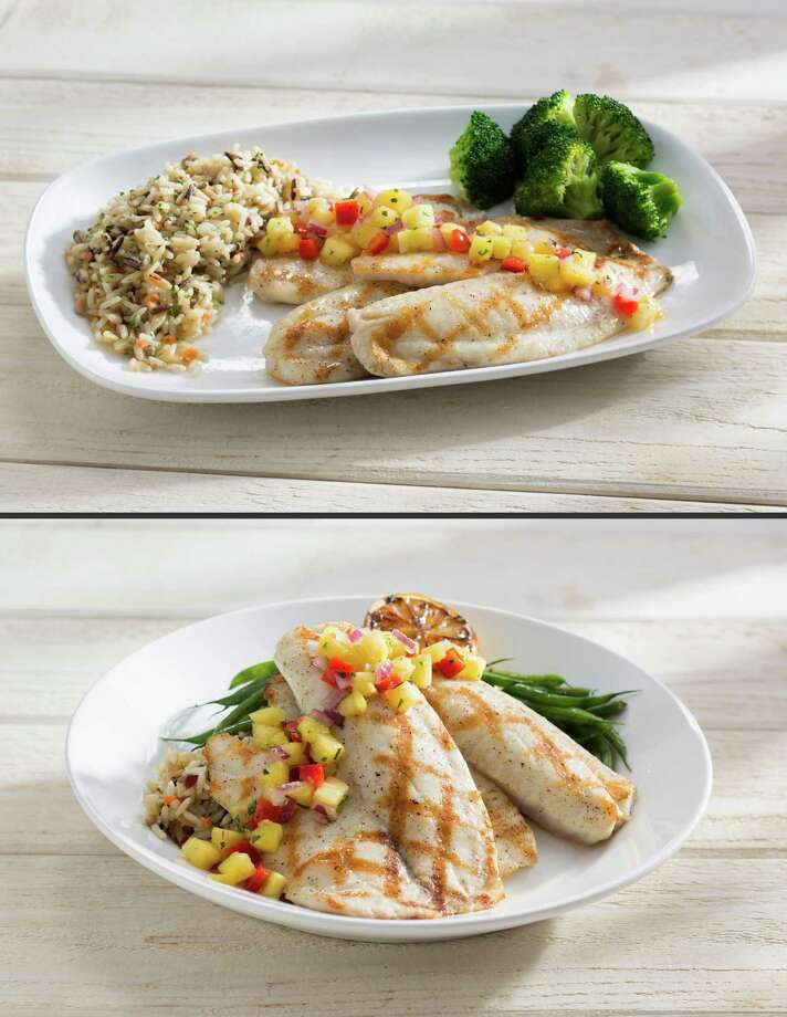 This combination made from photos provided by Red Lobster shows its Wood Grilled Tilapia, on rectangular plates, with the fish, rice and vegetables spread out separately, top; and the same dish on a circular plate on which slabs of fish are piled over the rice, an architectural presentation that is common at higher-end restaurants. The new plating style marks the latest attempt by the struggling seafood to right its course as it embarks on a new era. (AP Photo/Red Lobster) ORG XMIT: NYBZ113 Photo: Uncredited / Red Lobster