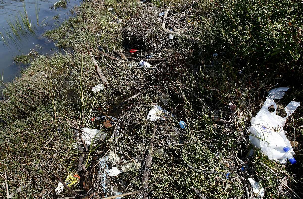 Trash along Damon Slough gets tangled in the growth near the shore as the tide fluctuates. Save the Bay issues its list of top trashiest spots in and around the San Francisco Bay which include Damon Slough in Oakland, Calif. and Mission Creek in San Francisco, Calif.