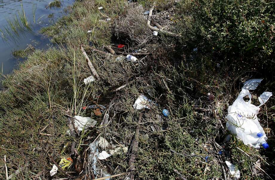 Trash along Damon Slough gets tangled in the growth near the shore as the tide fluctuates. Save the Bay issues its list of top trashiest spots in and around the San Francisco Bay which include Damon Slough in Oakland, Calif. and Mission Creek in San Francisco, Calif. Photo: Brant Ward, The Chronicle