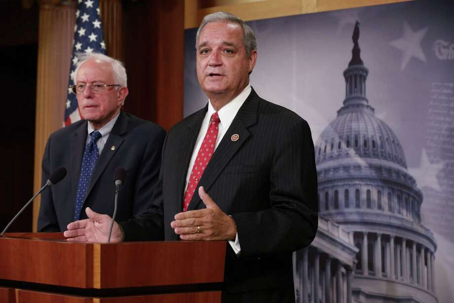 WASHINGTON, DC - JULY 28:  House Veterans Affairs Committee Chairman Jeff Miller (R-FL) (R) and Senate Veterans Affairs Committee Chairman Bernie Sanders (I-VT) hold a news conference to announce that the two committees have struck a deal to reform the Veterans Affairs Department at the U.S. Capitol July 28, 2014 in Washington, DC. Sanders and Miller worked through the weekend to craft legislation they could both agree to in the wake of a scandal over fasle reports about months-long waiting times for medical appointments at the VA's clinics and hospitals. Photo: Chip Somodevilla, Getty Images / 2014 Getty Images