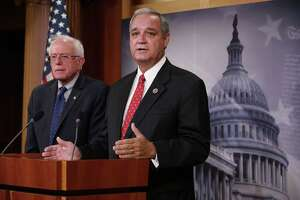 WASHINGTON, DC - JULY 28:  House Veterans Affairs Committee Chairman Jeff Miller (R-FL) (R) and Senate Veterans Affairs Committee Chairman Bernie Sanders (I-VT) hold a news conference to announce that the two committees have struck a deal to reform the Veterans Affairs Department at the U.S. Capitol July 28, 2014 in Washington, DC. Sanders and Miller worked through the weekend to craft legislation they could both agree to in the wake of a scandal over fasle reports about months-long waiting times for medical appointments at the VA's clinics and hospitals.